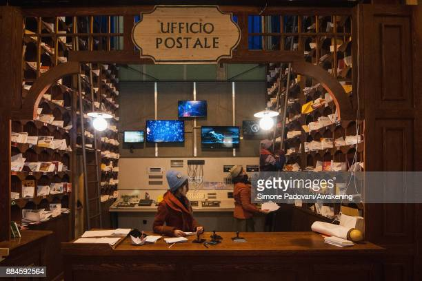 Santa's helpers work in the post office in the house of Santa Claus in the Reggia of Venaria on December 2 2017 in Turin Italy