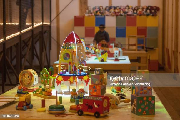 Santa's helpers work in the toys factory in the house of Santa Claus in the Reggia of Venaria on December 2 2017 in Turin Italy