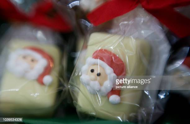 Santas made out of marzipan in Hamburg Germany 19 November 2013 Photo Pauline Willrodt | usage worldwide