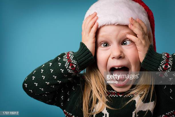 santa's stressed little helper wearing hat and christmas sweater - ugly girl stock photos and pictures