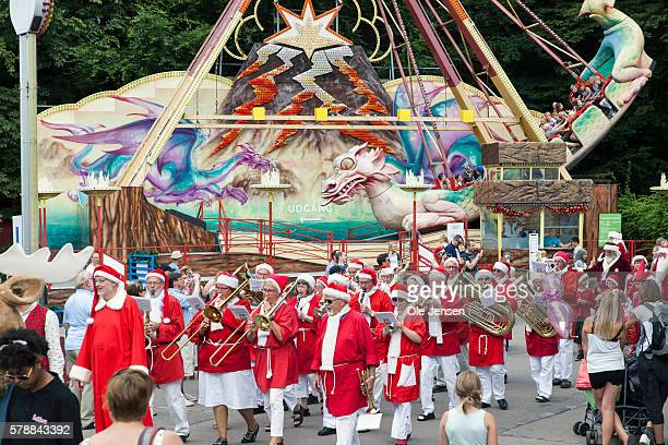 Santa'u2019s participating in the World Santa Claus Congress 2016 is parading through Bakken amusement park in Klampenborg Denmark on July 20 2016...