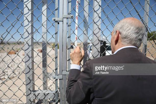 Sante Fe New Mexico Mayor Alan Webber looks through a gate after being told he could not cross through to the tent facility setup at the...