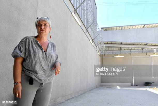Sante prison governor Christelle Rotach stands in the excercice yard during a visit of the Sante prison in Paris on June 28 2018 Closed since 2014...