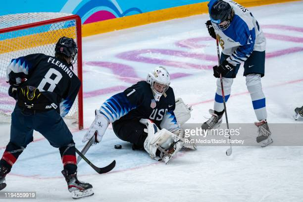 Santeri Sulku of Finland is scoring a goal against Goalkeeper Dylan Silverstein of United States during Men's 6Team Tournament Preliminary Round...