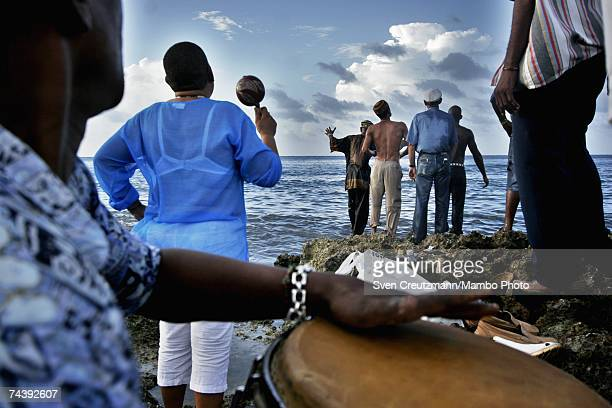 Santeria babalawo Victor Omolofaoro Betancourt President of the Association Ifa Iranlowo sends prayers to the santos or orishas in the ocean after...
