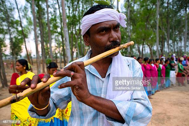 Santhal man plays flute The Santhal are the largest tribal community in India They have a distinct culture of their own mainly reflected in painting...