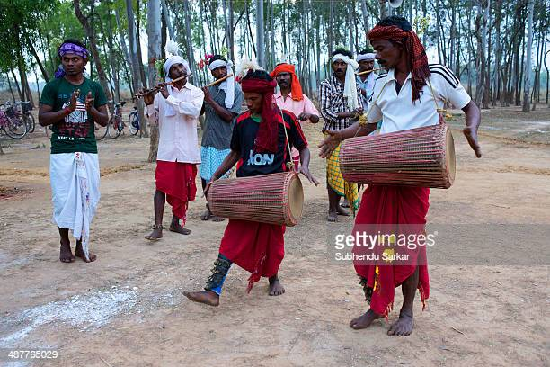Santhal men play drums during a festive celebration The Santhal are the largest tribal community in India They have a distinct culture of their own...