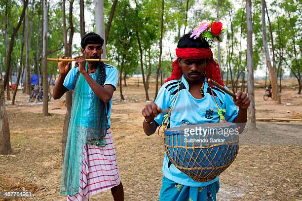 Santhali men play musical instruments during a festive celebration The Santhal are the largest tribal community in India They have a distinct culture...