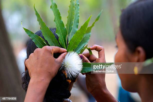 Santhali woman helps another to prepare her hairdo during a festive celebration The Santhal are the largest tribal community in India They have a...