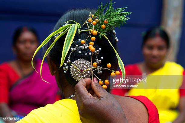 Santhali woman is helped to arrange her hairdo The Santhal are the largest tribal community in India They have a distinct culture of their own mainly...