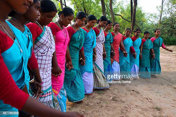 Santhali women dancing in a group The Santhal are the largest tribal community in India They have a distinct culture of their own mainly reflected in...