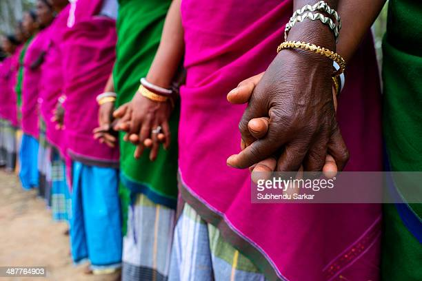 Santhali women hold hands before starting their dance The Santhal are the largest tribal community in India They have a distinct culture of their own...