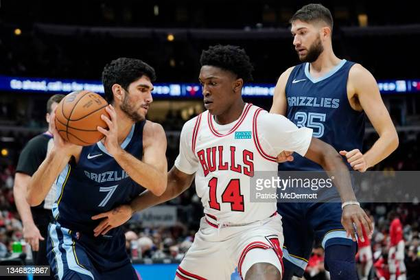Santi Aldama of the Memphis Grizzlies dribbles the ball against Stanley Johnson of the Chicago Bulls in the second half during a preseason game at...