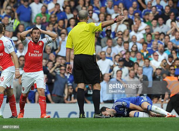 Santi Cazorl of Arsenal can't believe the referee Mike Dean has given a foul for a challenge on Cesc Fabregas of Chelsea during the Barclays Premier...