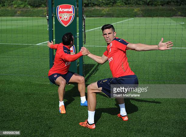 Santi Cazorla and Gabriel of Arsenal in action during a training session at London Colney on September 25 2015 in St Albans England