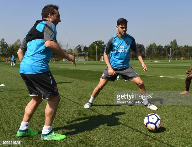 Santi Cazorla and Konstantinos Mavropanos of Arsenal during a training session at London Colney on May 8 2018 in St Albans England