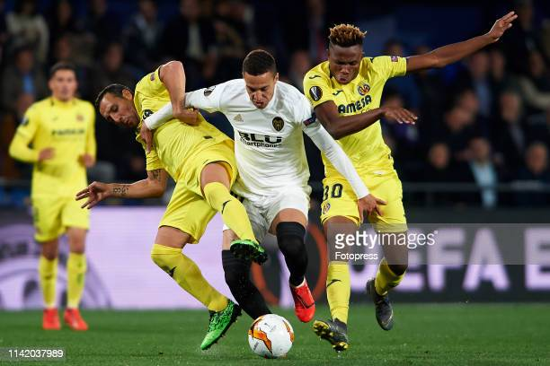 Santi Cazorla and Samuel Chukwueze of Villarreal CF competes for the ball with Rodrigo Moreno of Valencia CF during the UEFA Europa League Quarter...