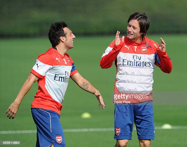 Santi cazorla and Tomas Rosicky of Arsenal during Arsenal Training Session at London Colney on September 22 2014 in St Albans England