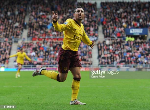 Santi Cazorla celebrates scoring a goal for Arsenal during the Barclays Premier League match between Sunderland and Arsenal at Stadium of Light on...
