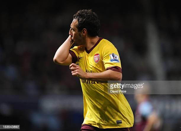 Santi Cazorla celebrates scoring Arsenal's third goal during the Barclays Premier League match between West Ham United and Arsenal at Boleyn Ground...
