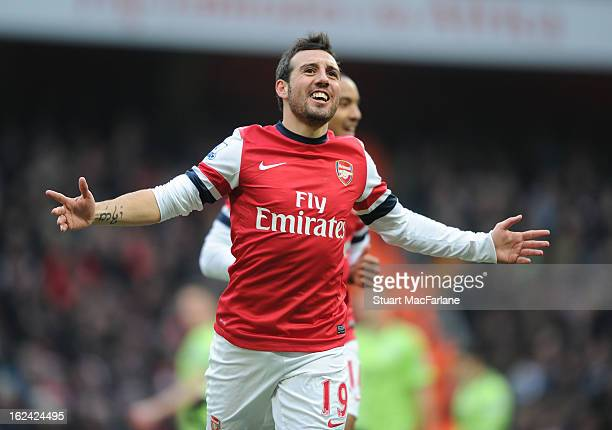 Santi Cazorla celebrates scoring for Arsenal during the Barclays Premier League match between Arsenal and Aston Villa at Emirates Stadium on February...