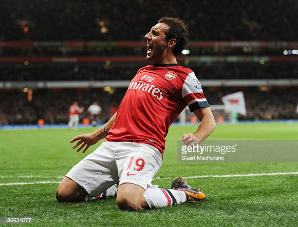 Santi Cazorla celebrates scoring for Arsenal during the Barclays Premier League match between Arsenal and Liverpool at Emirates Stadium on November...