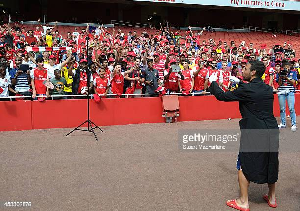 Santi Cazorla 'conducts' Arsenal fans during Members Day at Emirates Stadium on August 7 2014 in London England