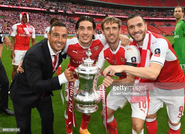 Santi Cazorla Hecotr Bellerin Nacho Monreal and Lucas Perez of Arsenal celebrate after the Emirates FA Cup Final between Arsenal and Chelsea at...