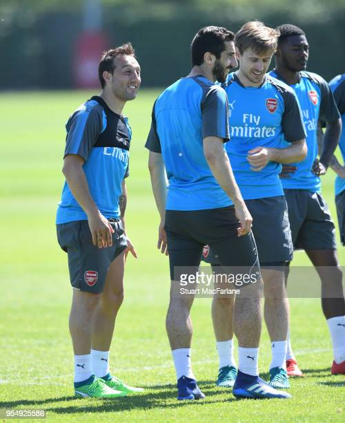 Santi Cazorla Henrikh Mkhitaryan and Nacho Monreal of Arsenal during a training session at London Colney on May 5 2018 in St Albans England