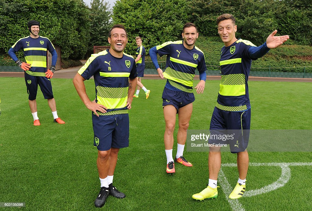 Santi Cazorla, Lucas Perez and Mesut Ozil of Arsenal during a training session at London Colney on September 12, 2016 in St Albans, England.