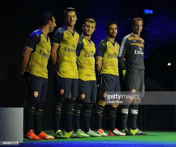 santi Cazorla Mesut Ozil Jack Wilshere Mathieu Flamini and Petr Cech of Arsenal during the Arsenal and Puma Launch the 201516 away kit at the...