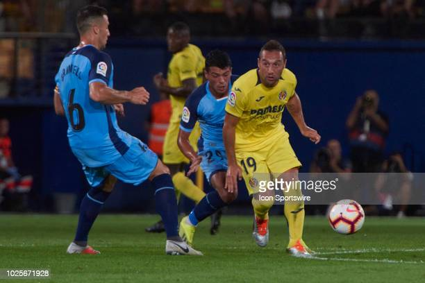 Santi Cazorla midfielder of Villarreal CF competes for the ball with Alex Granell midfielder of Girona FC during the La Liga match between Villarreal...