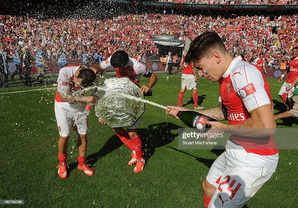 Santi Cazorla, Mikel Arteta and Hector Bellerin celebrate after the FA Community Shield match between Chelsea and Arsenal at Wembley Stadium on August 2, 2015 in London, England.