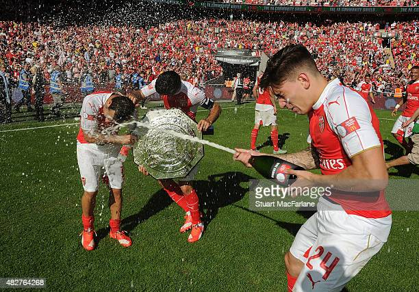 Santi Cazorla Mikel Arteta and Hector Bellerin celebrate after the FA Community Shield match between Chelsea and Arsenal at Wembley Stadium on August...