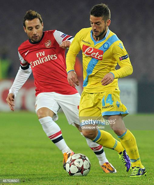 Santi Cazorla of Arsenal and Dries Mertens of Napoli in action during the UEFA Champions League Group F match between SSC Napoli and Arsenal at...