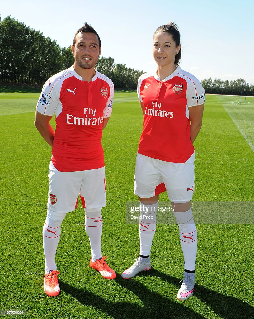 Santi Cazorla of Arsenal and Vicky Losada of Arsenal Ladies during the Arsenal 1st Team Group Photograph at London Colney on September 10, 2015 in St Albans, England.