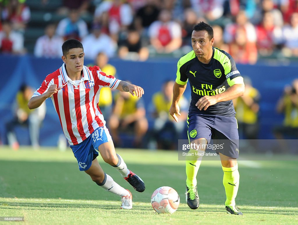 Santi Cazorla of Arsenal breaks past Edson Torres of Chivas during the pre season friendly match between Arsenal and CD Guadalajara at StubHub Center on July 31, 2016 in Carson, California.