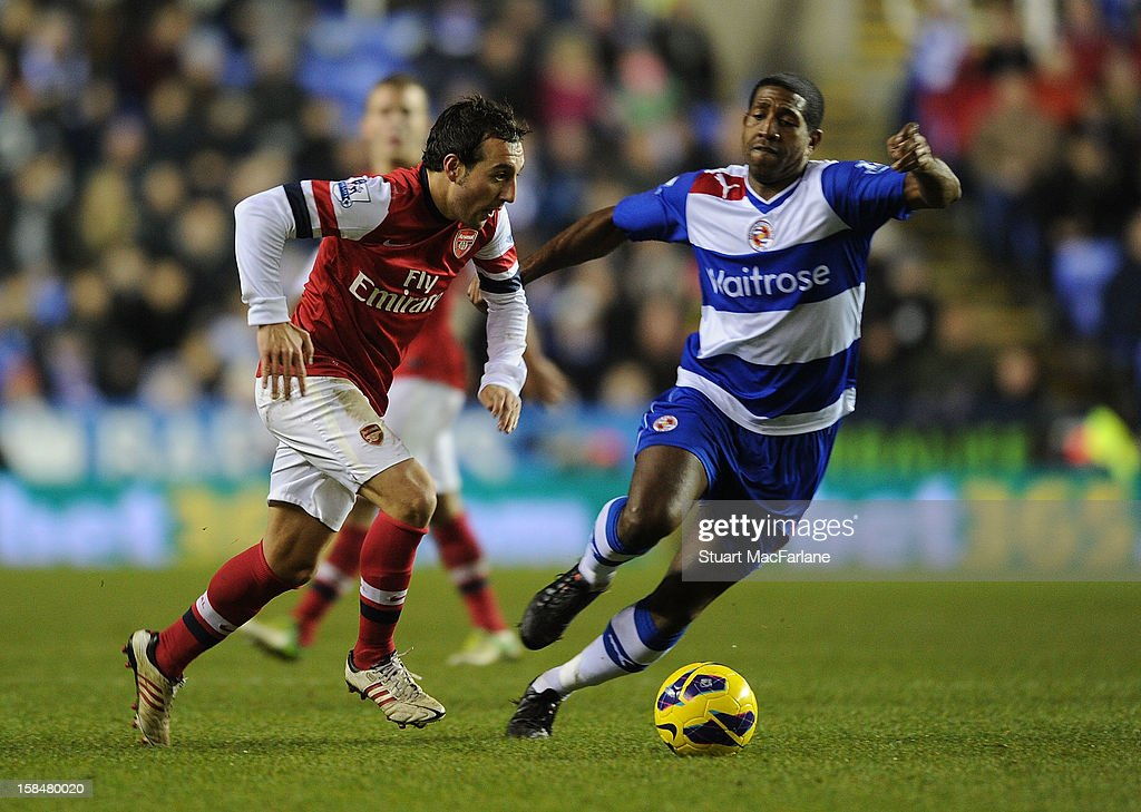 Santi Cazorla of Arsenal breaks past Mikele Leigertwood (R) of Reading during the Barclays Premier League match between Reading and Arsenal at Madejski Stadium on December 17, 2012 in Reading, England.