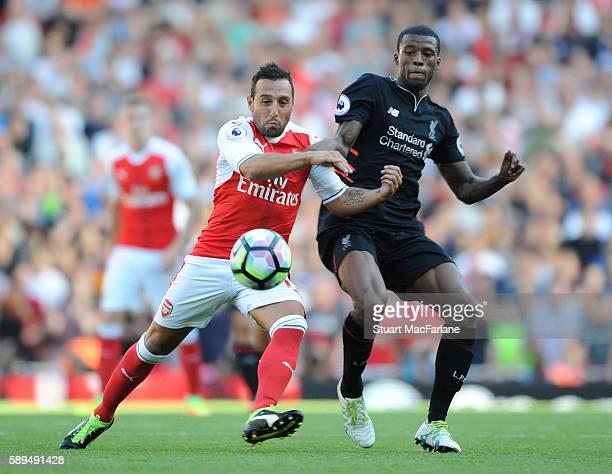Santi Cazorla of Arsenal breaks pasy Georginio Wijnaldum during the Premier League match between Arsenal and Liverpool at Emirates Stadium on August...
