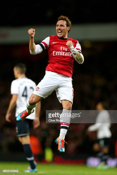 Santi Cazorla of Arsenal celebrates after scoring the opening goal during the Budweiser FA Cup match between Arsenal and Tottenham Hotspur at...