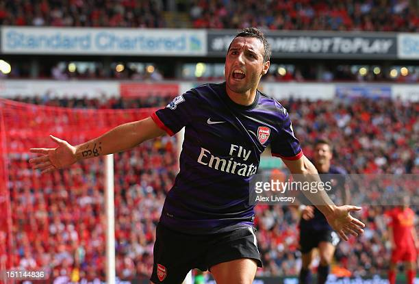 Santi Cazorla of Arsenal celebrates after scoring the second goal during the Barclays Premier League match between Liverpool and Arsenal at Anfield...