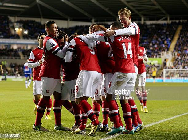 Santi Cazorla of Arsenal celebrates after scoring their fourth goal during the Barclays Premier League match between Reading and Arsenal at Madejski...