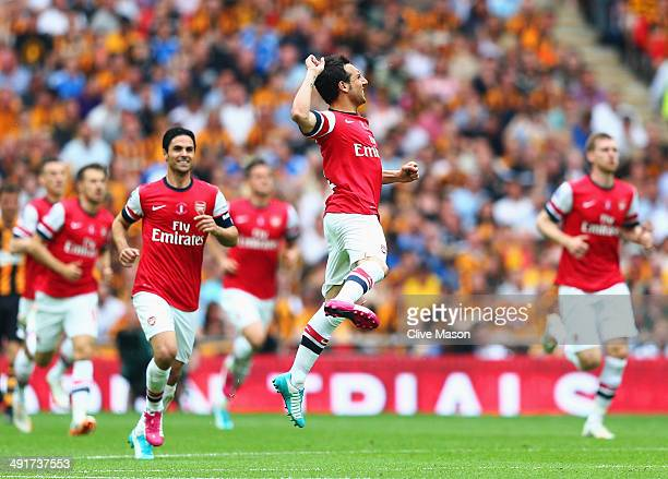 Santi Cazorla of Arsenal celebrates as he scores their first goal from a free kick during the FA Cup with Budweiser Final match between Arsenal and...