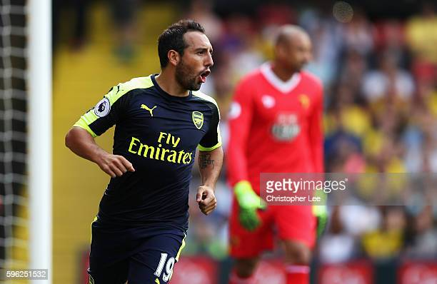 Santi Cazorla of Arsenal celebrates scoring his sides first goal during the Premier League match between Watford and Arsenal at Vicarage Road on...