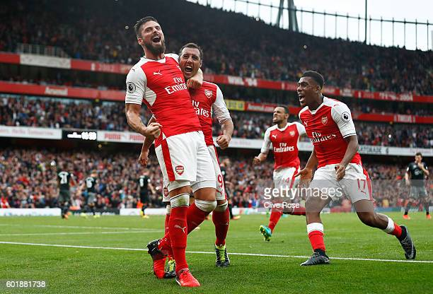 Santi Cazorla of Arsenal celebrates scoring his sides second goal with Olivier Giroud of Arsenal and Alex Iwobi of Arsenal during the Premier League...