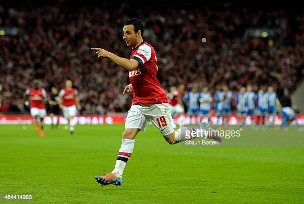 Santi Cazorla of Arsenal celebrates scoring the winning penalty during the shoot out during the FA Cup SemiFinal match between Wigan Athletic and...