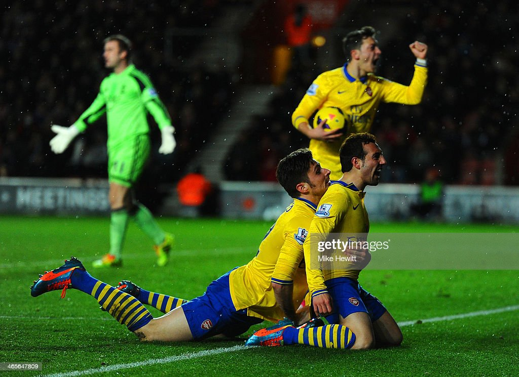 Santi Cazorla of Arsenal celebrates scoring their second goal with Olivier Giroud of Arsenal during the Barclays Premier League match between Southampton and Arsenal at St Mary's Stadium on January 28, 2014 in Southampton, England.