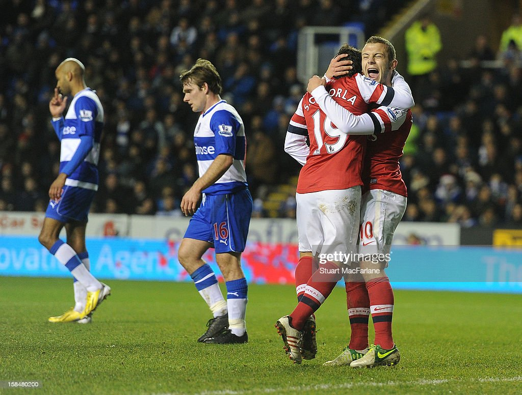 Santi Cazorla (C) of Arsenal celebrates with Jack Wilshere (R) after scoring their fourth Arsenal goal, as Jimmy Kebe (L) and Jay Tabb (2nd L) of Reading look on during the Barclays Premier League match between Reading and Arsenal at Madejski Stadium on December 17, 2012 in Reading, England.