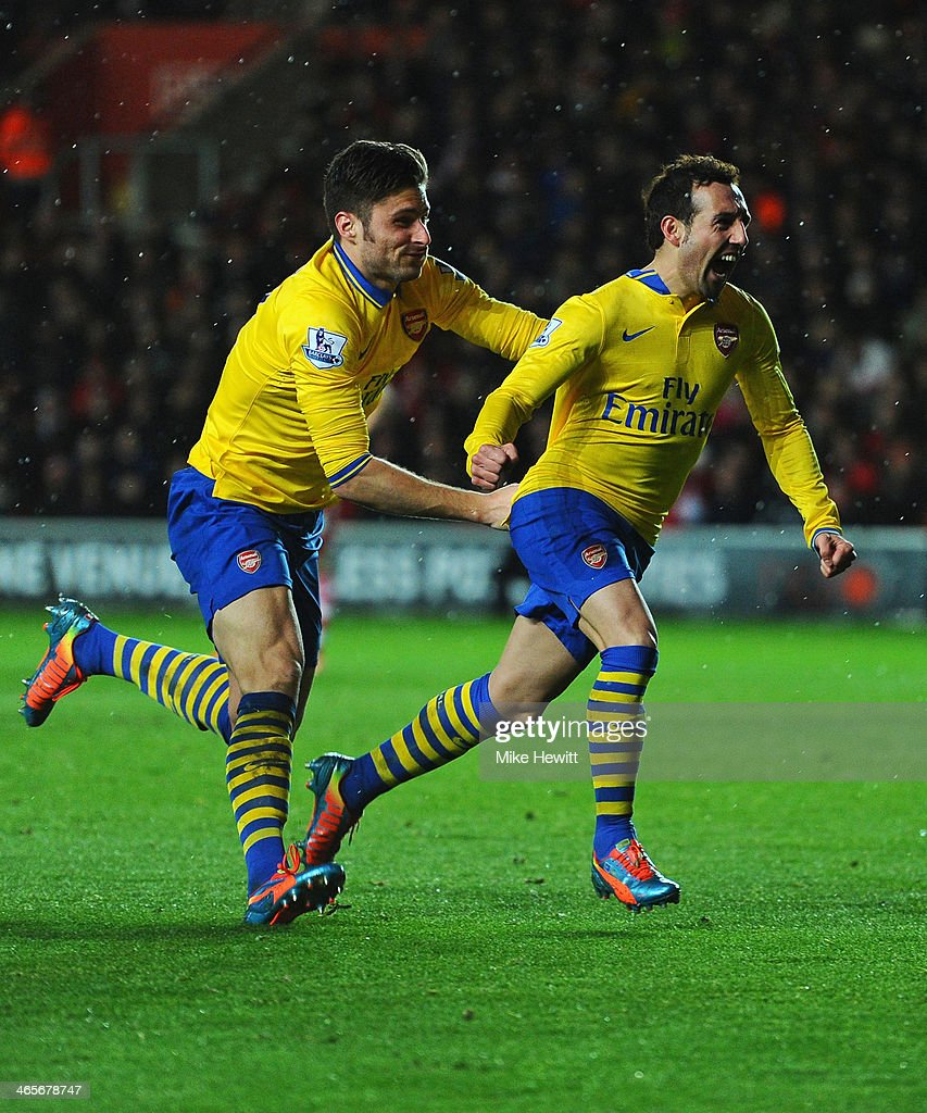 Santi Cazorla of Arsenal celebrates with Olivier Giroud after scoring during the Barclays Premier League match between Southampton and Arsenal at St Mary's Stadium on January 28, 2014 in Southampton, England.