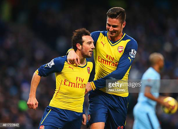 Santi Cazorla of Arsenal celebrates with Olivier Giroud as he scores their first goal from a penalty during the Barclays Premier League match between...